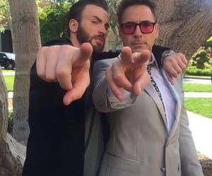 chris evans, robert downey jr, and Marvel image