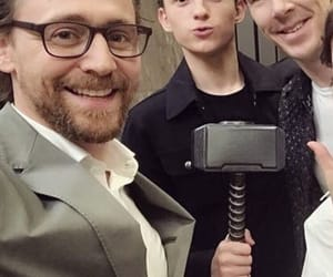 tom holland, tom hiddleston, and Marvel image