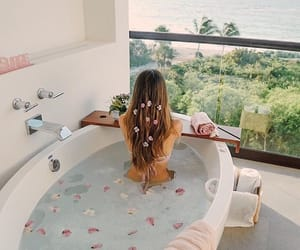 flowers, spa, and tub image