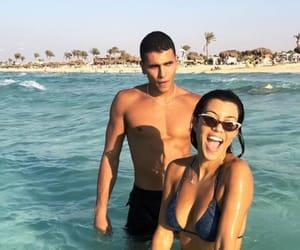 couple and kourtney kardashian image