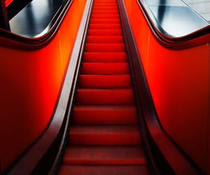 escalator, red, and stairs image