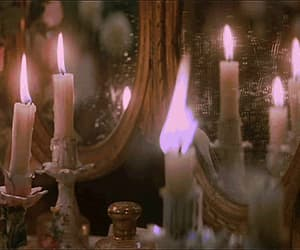 candle, gif, and mirror image