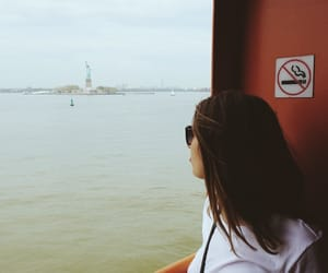 girl, manhattan, and statue of liberty image