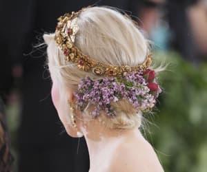 met gala, emilia clarke, and flowers image