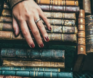 books, vintage, and hand image