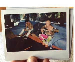 anthony kiedis, flea, and guitar image