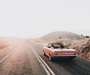 sun, car, and road image