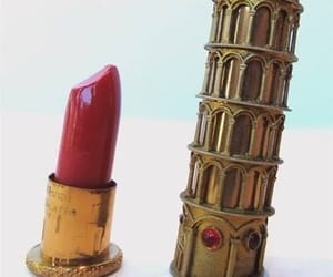 lipstick and pisa crooked tower. image