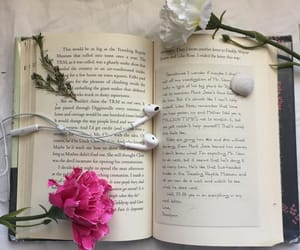 book, flower, and headphones image