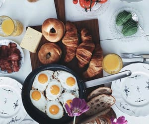 bread, fried eggs, and croissants image