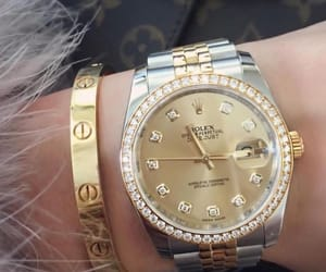 cartier, gold, and rolex image