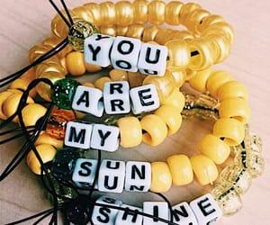 bracelet, yellow, and sunshine image