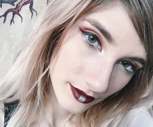 eyeliner, dark make up, and fake piercing image