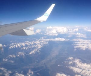 airplane, Flying, and mountains image