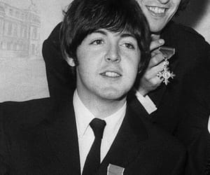 george harrison, Paul McCartney, and he's in the background image