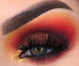 lashes, gold shadow, and make up image