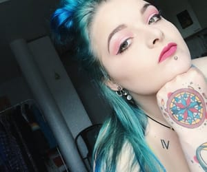 hand tattoo, lip piercing, and makeup image