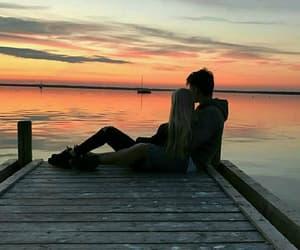hug, sea, and sunset image