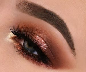make up, brown shadow, and blue eyes image