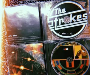 the strokes, is this it, and room on fire image