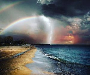 rainbow, storm, and beach image