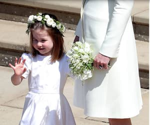 Princess Charlotte of Cambridge waves after attending the wedding ceremony of Britain's Prince Harry, Duke of Sussex and US actress Meghan Markle at St George's Chapel, Windsor Castle, in Windsor, on May 19, 2018.