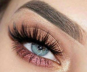 blue eyes, lashes, and gold shadow image