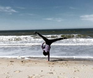 beach, handstand, and tricks image