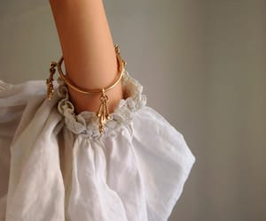 white, gold, and bracelet image