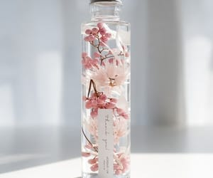 pink, bottle, and flowers image