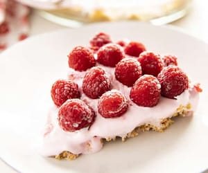 Raspberry Lemonade Pie is an absolutely delicious cool and creamy summer treat! This no-bake lemonade pie is easy to fix with only a few ingredients and topped with fresh raspberries making it as gorgeous as it is tasty!