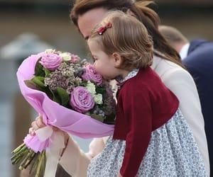 kate middleton, princess charlotte, and baby image