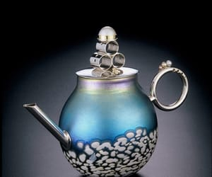 blown glass, pearl, and teapot image