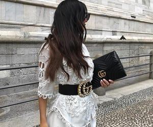 belt, brunette, and diva image