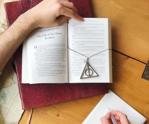 books, hands, and necklace image