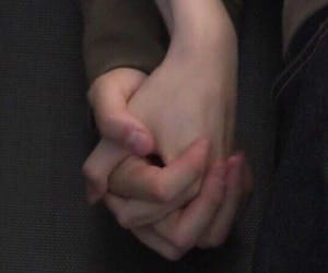 couple, kiss, and holding hands image