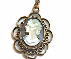 black and white, cameo jewelry, and carved image
