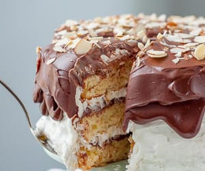 a piece of almond joy cake being taken out of cake