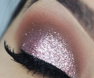 "Ooo a pink glittery & shimmery eyelid that's pretty yet in no way ""princess"". Love."