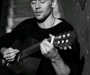 tom hiddleston, loki, and guitar image