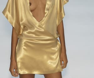 runway, golden dress, and model of color image