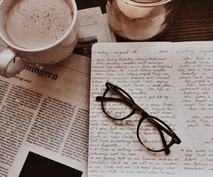 coffee, glasses, and newspaper image
