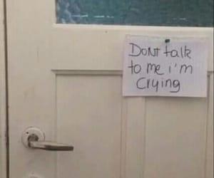 sad, crying, and door image