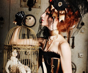 birdcage, doll, and cage image