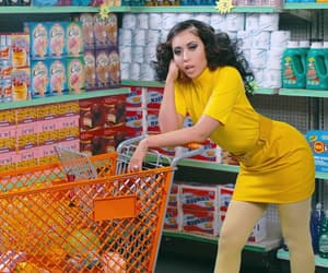 kali uchis, yellow, and after the storm image