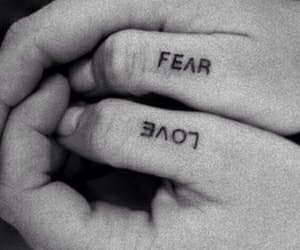 love, fear, and tattoo image