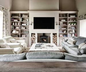 books, cozy, and fireplace image