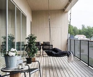balcony, wooden floor, and hanging chair image