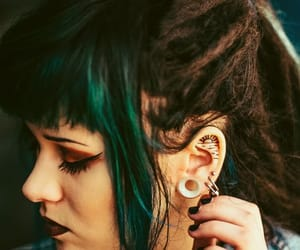 dreadlocks, stretched ears, and half and half hair image