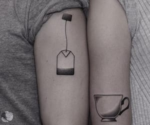 arm tattoo, black ink, and tattoo image